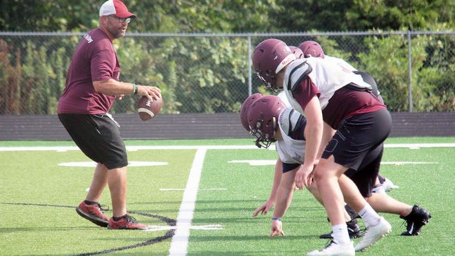 Osage assistant coach Shawn Fowler works with football players during camp on July 14 in Osage Beach.