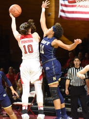 Marist College's Maura Fitzpatrick attempts a layup while Navy's Kaila Clark defends at McCann Arena in Poughkeepsie in November.