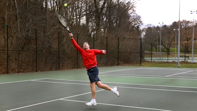 Paul Seeberger of Irondequoit said he never thought he'd be playing tennis outside in shorts on Dec. 21, but here he is at Cobbs Hill.