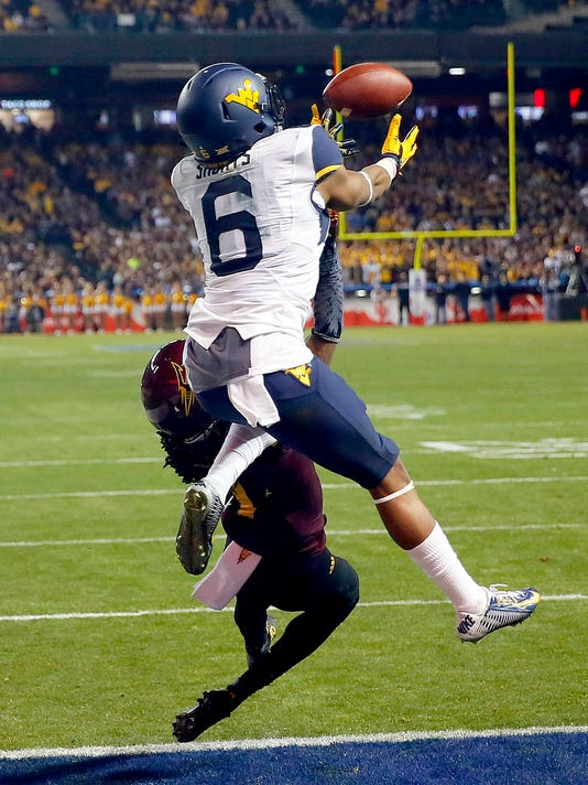 West Virginia wide receiver Daikiel Shorts (6) pulls in a touchdown catch as Arizona State defensive back Solomon Means (7) defends during the second half of the Cactus Bowl NCAA college football game, Saturday, Jan. 2, 2016, in Phoenix. (AP Photo/Matt York)