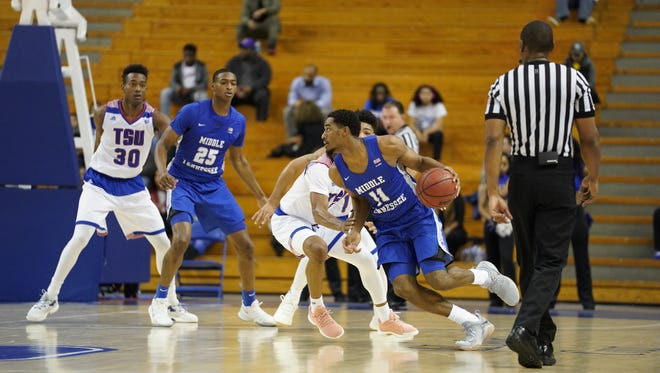 MTSU guard Ed Simpson looks for an open teammate in a game against Tennessee State at Gentry Center on Nov. 18, 2017.