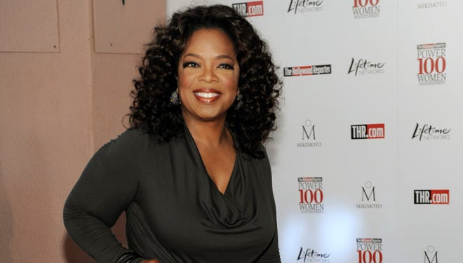 Oprah Winfrey arrives at The Hollywood Reporter's annual Women in Entertainment Breakfast in Beverly Hills, Calif.