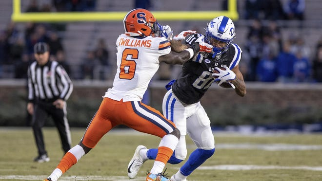 Duke's Aaron Young (81) carries the ball as Syracuse's Trill Williams (6) attempts a tackle during an NCAA college football game in Durham, N.C., Saturday, Nov. 16, 2019.