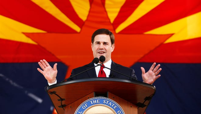 Gov. Doug Ducey speaks during his inauguration, wherein he promised to deliver a strong, healthy Arizona economy.
