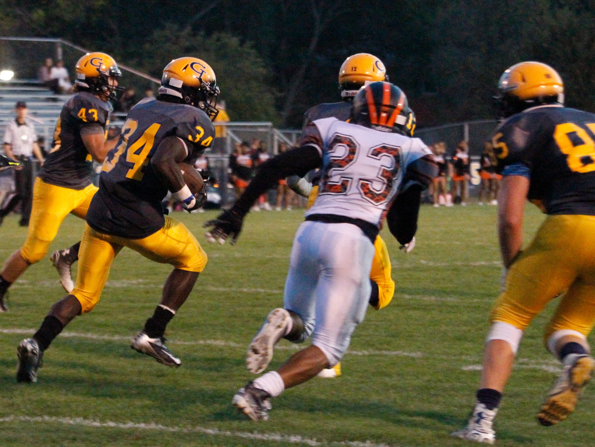 Grand Ledge RB Ba Blamo finds a hole against Jackson September 25, 2015, at Grand Ledge. [MATTHEW DAE SMITH | for the Lansing State Journal]