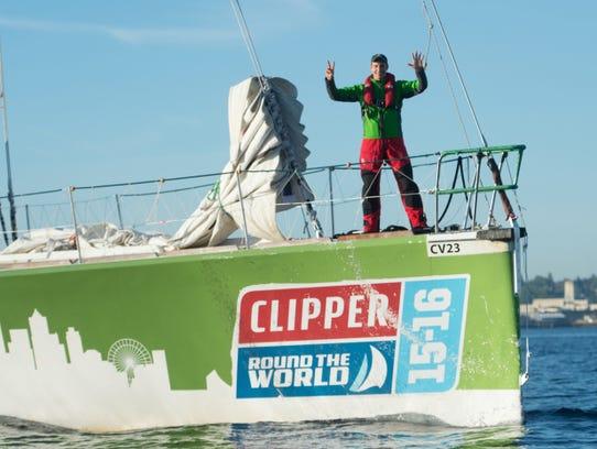Martin Frey celebrates as he finishes sailing the last