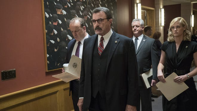 In Friday's season premiere of 'Blue Bloods,' Lt. Gormley (Robert Clohessy), left, police commissioner Frank Reagan (Tom Selleck),  DCPI Garrett Moore (Gregory Jbara), Abigail Baker (Abigail Hawk) are dealing with a potential threat to New York City.