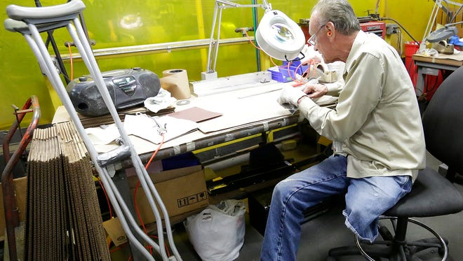 Ed Miller works at his station at Mid-States Aluminum Corp. More than 50 years ago, Mid-States in Fond du Lac hired Miller, who lost his leg at age 17 after suffering injuries in a car crash.