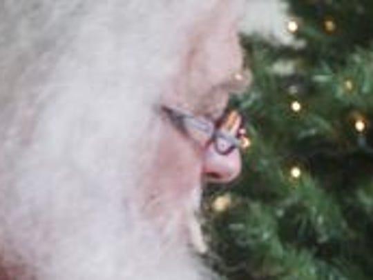 Alexander Johnson, 4, joyfully runs up to Santa after