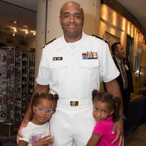 U.S. Navy Lt. Commander Bashon Mann with his daughters