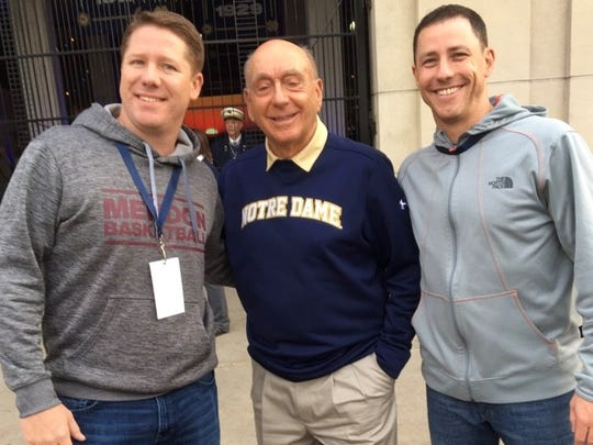 The Nally brothers, Bob (left) and John, pose for a picture with ESPN college basketball analyst, Dick Vitale, last year during a visit to Notre Dame. John is in his 18th year as Pittsford Sutherland's boys basketball coach; Bob is in his third at Pittsford Mendon.