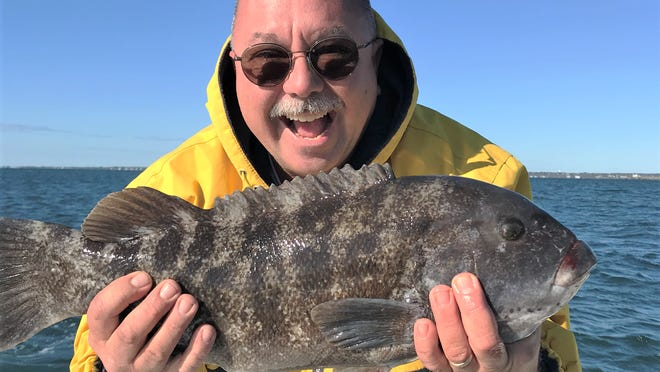 Eric Travis of Riverside with a 21-inch tautog he caught off Newport in the Brenton Reef area using a 3-ounce Tsunami yellow/green jig head with a full green crab.