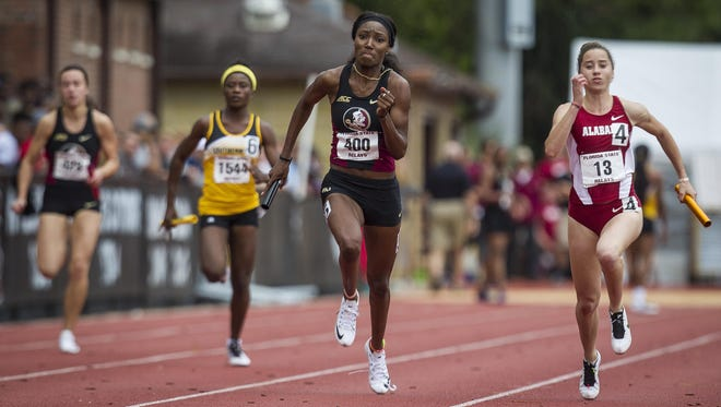 FSU's Der'Renae Freeman edges out Alabama's Olivia Fotopoulou in the Women's 4x100m relay. Several colleges in the southeast competed despite the inclement weather during the FSU Relays at Mike Long Track on Friday.