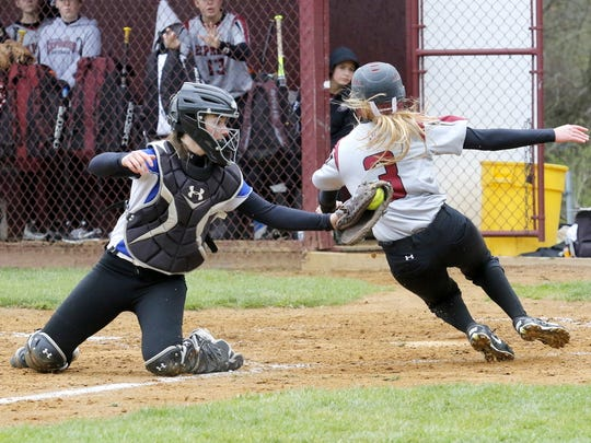 Danielle Dille of Elmira slides safely into home just