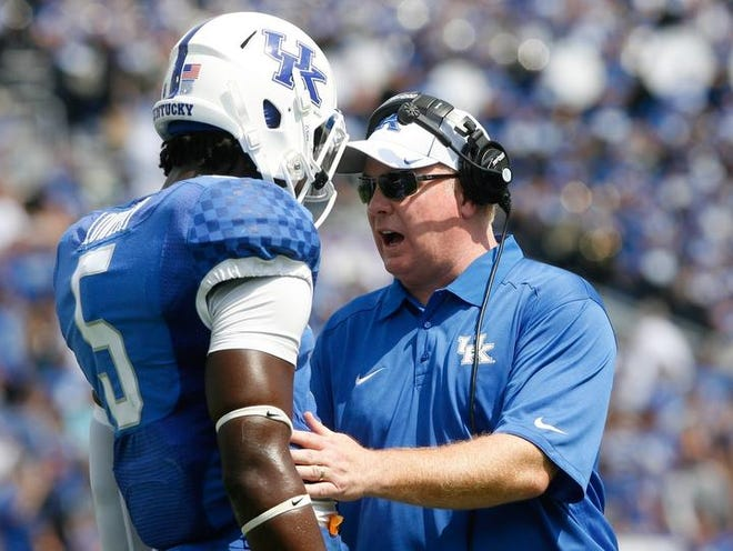 UK coach Mark Stoops, a former Florida State assistant, will be rooting for the Seminoles when they play the Southeastern Conference's Auburn in next month's BCS national title game.