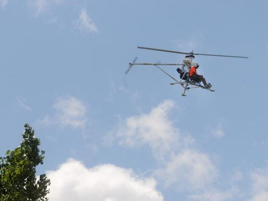 A man pilots his ultralight aircraft on Saturday at EAA AirVenture 2013 in Oshkosh, Wis., on August 3, 2013.