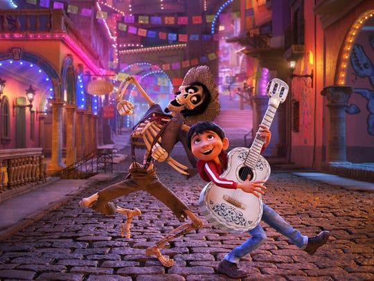 Hector, voiced by Gael García Bernal, left, and Miguel,