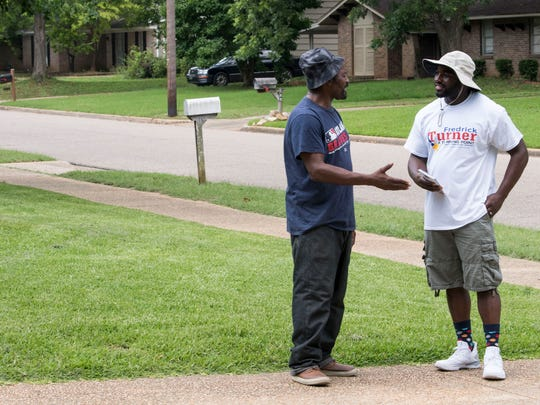 Michael Croxton, left, talks with Fredrick Turner, Democratic candidate for Montgomery Board of Education District 1, Saturday, June 16, 2018, as Turner campaigns to win the runoff in the Pecan Grove neighborhood of Montgomery, Ala.