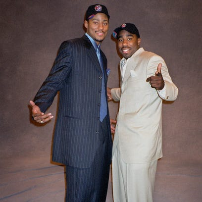 Morris Peterson, left, and Mateen Cleaves, pose at