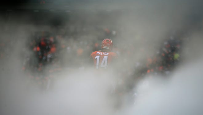 Cincinnati Bengals quarterback Andy Dalton (14) takes the field as he's introduced before the first quarter of the NFL Week 13 game between the Cincinnati Bengals and the Philadelphia Eagles at Paul Brown Stadium in downtown Cincinnati on Sunday, Dec. 4, 2016.