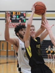 Hendersonville's Zach Morris shoots in front of Mt. Juliet's Isaac Stephens on Fri. Feb. 2, 2018. Photo by Dave Cardaciotto