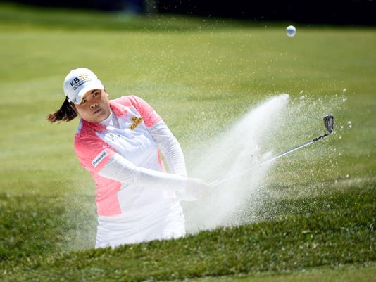 Inbee Park hits out of a sand trap on the first green during the third round of the KPMG Women's PGA golf championship at Westchester Country Club in Harrison, N.Y. Park hit a 7-under 66 to grab the third-round lead.