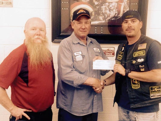 """Courtesy Photo   Deming Elks 2750 Exalted Ruler Jerry Pingleton, center, presented a 1,000 check to the Combat Vets Motorcycle Association to assist the group in its third annual Vets Helping Vets Motorcycle Run. Flanking Pingleton is Sonny """"Red"""" Garney, left, and  J.R. """"Smoke"""" Luna of the Combat Vets."""