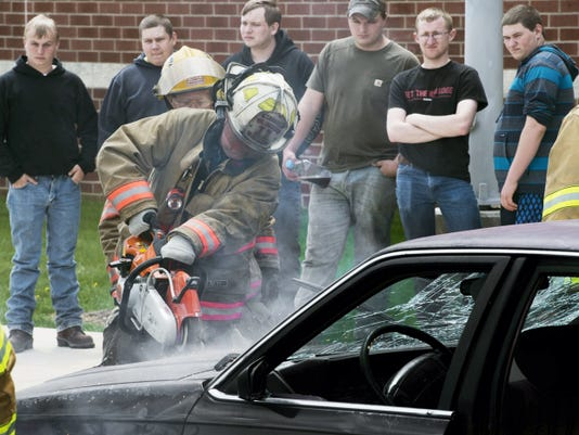 Spring Grove Area High School students watch Brad Dunham, a deputy chief for the Nashville Volunteer Fire Company cut into the hood of a vehicle during the Students Against Destructive Decisions Club annual Safety Bug demonstration on April 28. Firefighters from Spring Grove, East Berlin and Thomasville also participated.