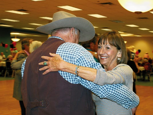 Bill Armendariz - Headlight Photo   Elaine Huismann and Bob Bachen trip the light fantastic on the dance floor during Saturday's 102nd annual Old Timer's Association of Luna County Banquet and Dance at the Special Events Center. See more photos from the event on Page A5.