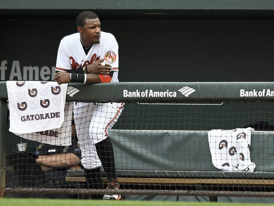 Baltimore's Adam Jones watches from the dugout in the eighth inning against the Washington Nationals on Sunday in Baltimore. Jones hit two homers, but the Nationals still won, 3-2.