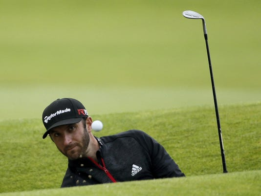 Dustin Johnson plays out of a bunker on the 17th hole during the third round of the British Open at St. Andrews, Scotland, on Sunday.