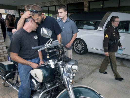 Justin McKinsey, left, is consoled by Bobby Baublitz before riding his mother's 1972 Harley-Davidson Shovelhead in her funeral procession in Red Lion. Many on bikes turned out to celebrate the life of Sharon 'Weezie' McKinsey, who ran a custom motorcycle shop together with her husband, Rick.