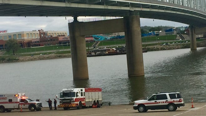 Cincinnati emergency crews recovered a body underneath the railroad bridge just west of the Brent Spence.