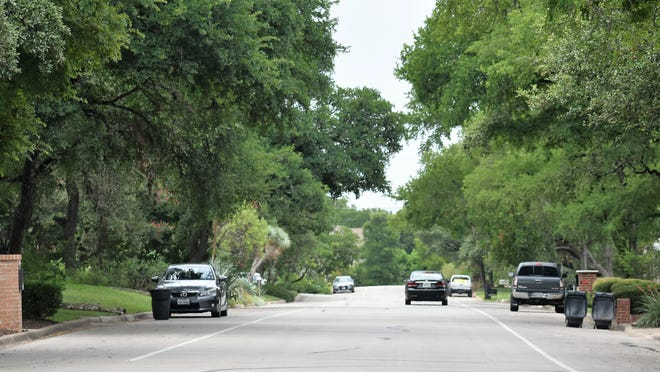 As the cicadas chirp,  a car drives slowly down a quiet Vale Street on Monday. A home at the end of the block has been the subject of recent Rollingwood City Council discussions as members debate whether to rezone the tract and purchase the property to serve as a new or interim police station.