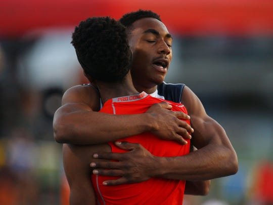 La Quinta High School senior Koty Burton celebrates his win in the 300-meter hurdles at Master's Meet at Cerritos College Stadium on May 27, 2016 with his best competition and second place winner Cameron Samuel of Rancho Verde High School.