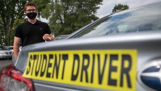 Asher Meltzer, 15, of Bloomfield Hills finishes his day of driver training at Official Driving School at their headquarters in Royal Oak Thursday, July 23, 2020.