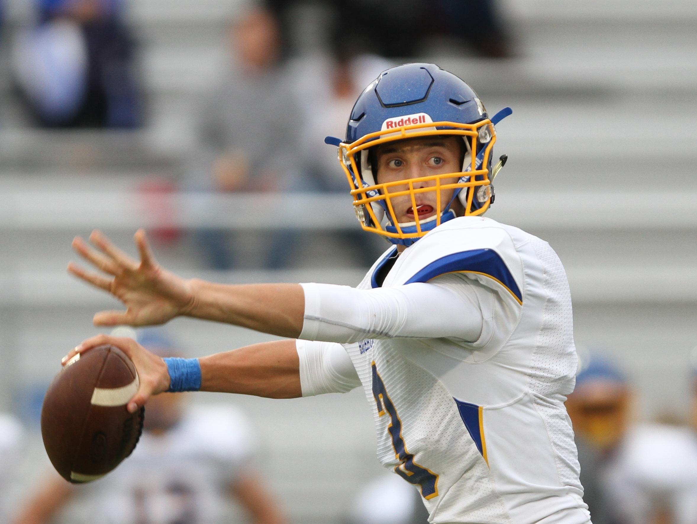 Wren quarterback Jay Urich (3) sets to pass against Daniel friday night at Daniel High School, October 2, 2015.