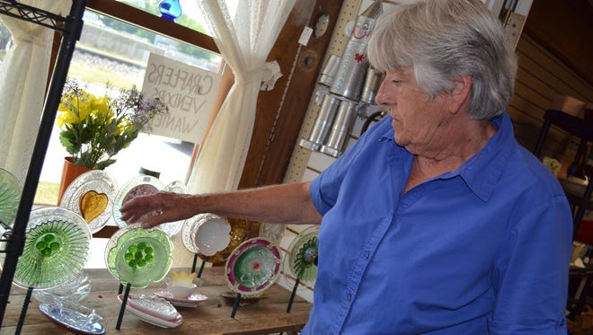 Ginny Minich makes Glass Garden Flowers out of vintage plates and dishes. Many of the artistic pieces Minich sells at Past & Present Emporium are made from recycled goods.