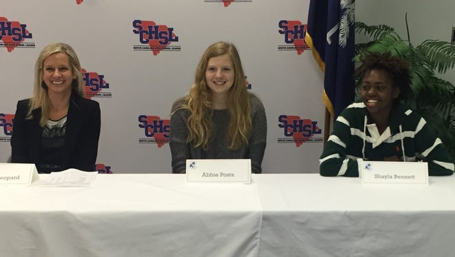 Christ Church girls basketball coach Toni Leopard, left, and seniors Abbie Posta, center, and Shayla Bennett share a laugh during Monday's state finals news conference at the South Carolina High School League.