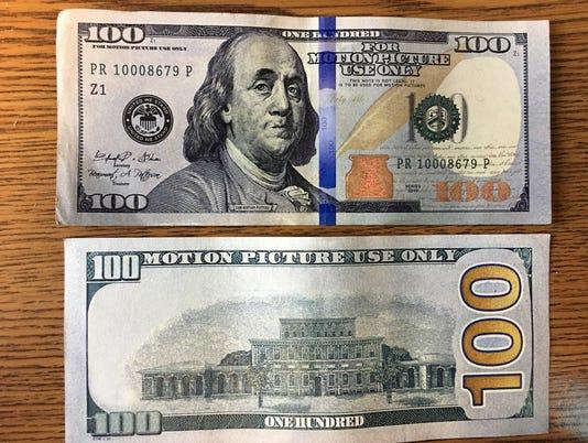 636494458604971755-counterfeit-money.jpg
