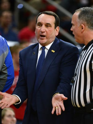 Jan 11, 2015; Raleigh, NC, USA; Duke Blue Devils head coach Mike Krzyzewski (left) reacts to a call during the first half against the North Carolina State Wolfpack at PNC Arena. Mandatory Credit: Rob Kinnan-USA TODAY Sports