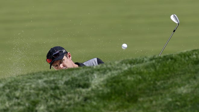 Adam Scott, of Australia, hits out of the bunker on the 18th hole during a practice round for the U.S. Open golf championship at Oakmont Country Club on Wednesday, June 15, 2016, in Oakmont, Pa. (AP Photo/John Minchillo)