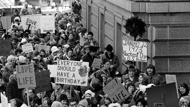 """An estimated 5,000 people, women and men, march around the Minnesota Capitol building protesting the U.S. Supreme Court's Roe v. Wade decision, ruling against state laws that criminalize abortion, in St. Paul, Minn., Jan. 22, 1973. The marchers formed a """"ring of life"""" around the building."""