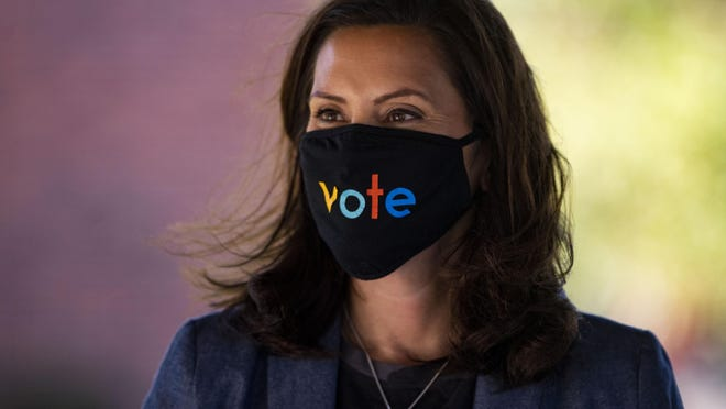 "Governor Gretchen Whitmer wears a mask with the word ""vote"" displayed on the front during a roundtable discussion on healthcare on Wednesday Oct. 7, 2020, in Kalamazoo."