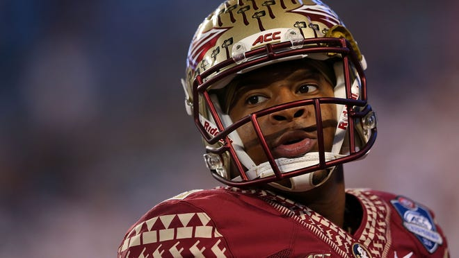 CHARLOTTE, NC - DECEMBER 06: Jameis Winston #5 of the Florida State Seminoles warms up before the game against the Georgia Tech Yellow Jackets at the ACC Championship game on December 6, 2014 in Charlotte, North Carolina. (Photo by Mike Ehrmann/Getty Images)