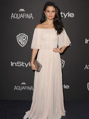 Selena Gomez opted for a cascading Grecian gown after