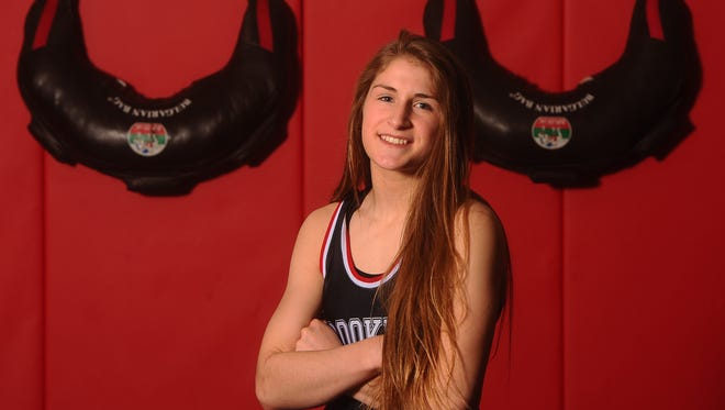 Ronna Heaton, a sophomore at Brookings High School, is the first girl ever to qualify for the S.D. state wrestling meet this weekend.