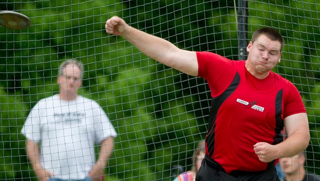 Newman's Jeff Ford throws the discuss during the WIAA division 3 sectional track meet at Rosholt High School, Friday, May 29, 2015.