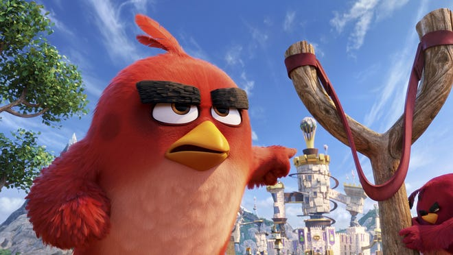 """Red, voiced by Jason Sudeikis, is seen in """"The Angry Birds Movie."""" The lonely outsider becomes a hero by turning himself and his neighbors into slingshot-launched missiles raining feathery terror down on their piggy enemies."""