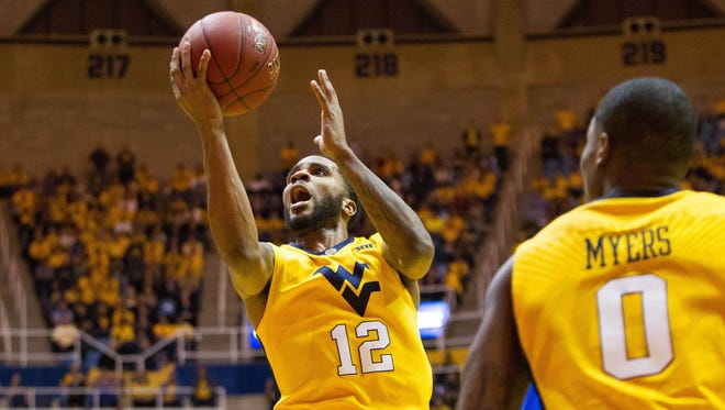 West Virginia guard Tarik Phillip shoots in the lane during the second half of the Mountaineers' upset of Kansas.